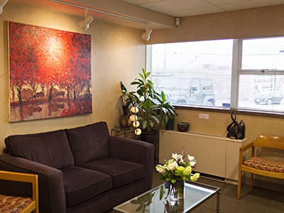 slide show image Dentistry With Smiles Kelsey Ullsmith DMD reception room couch CB 5664