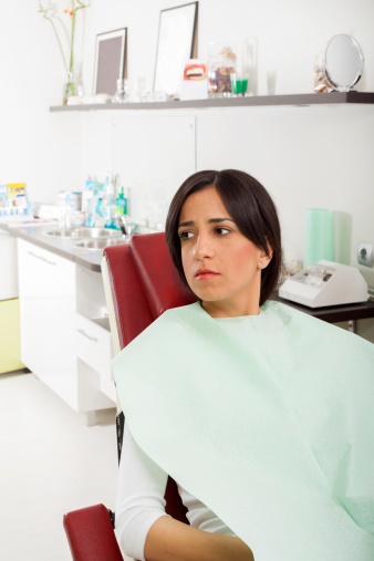 A woman suffering from dental anxiety.